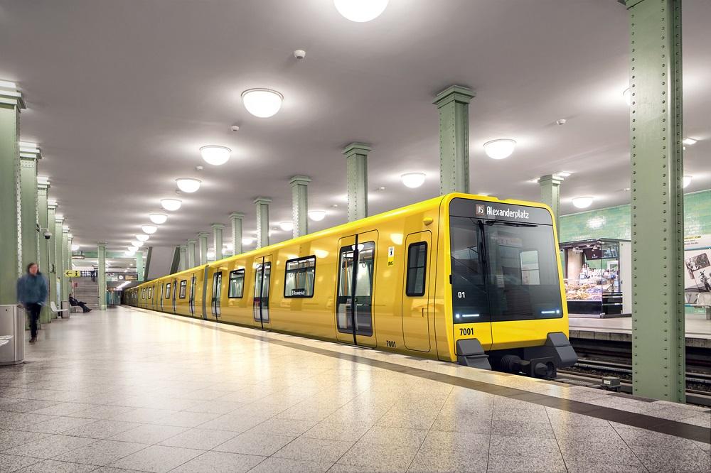A BVG underground train at Alexanderplatz station. The artist's impression shows a future class J wide gauge train