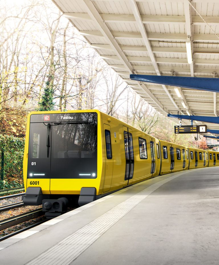 The artist's impressions shows the future class JK narrow gauge train at Olympiastadion station